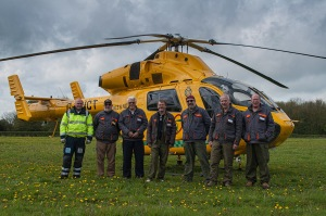 Some of the crew in front of the Lincs & Notts Air Ambulance, and it's pilot Tim