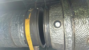 The jet pipe dis-connected, the yellow strap supports the pipe and connects to an overhead trunnion