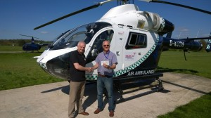 Paul handing over the donation to Larry from the Air Ambulance Service at Redhill